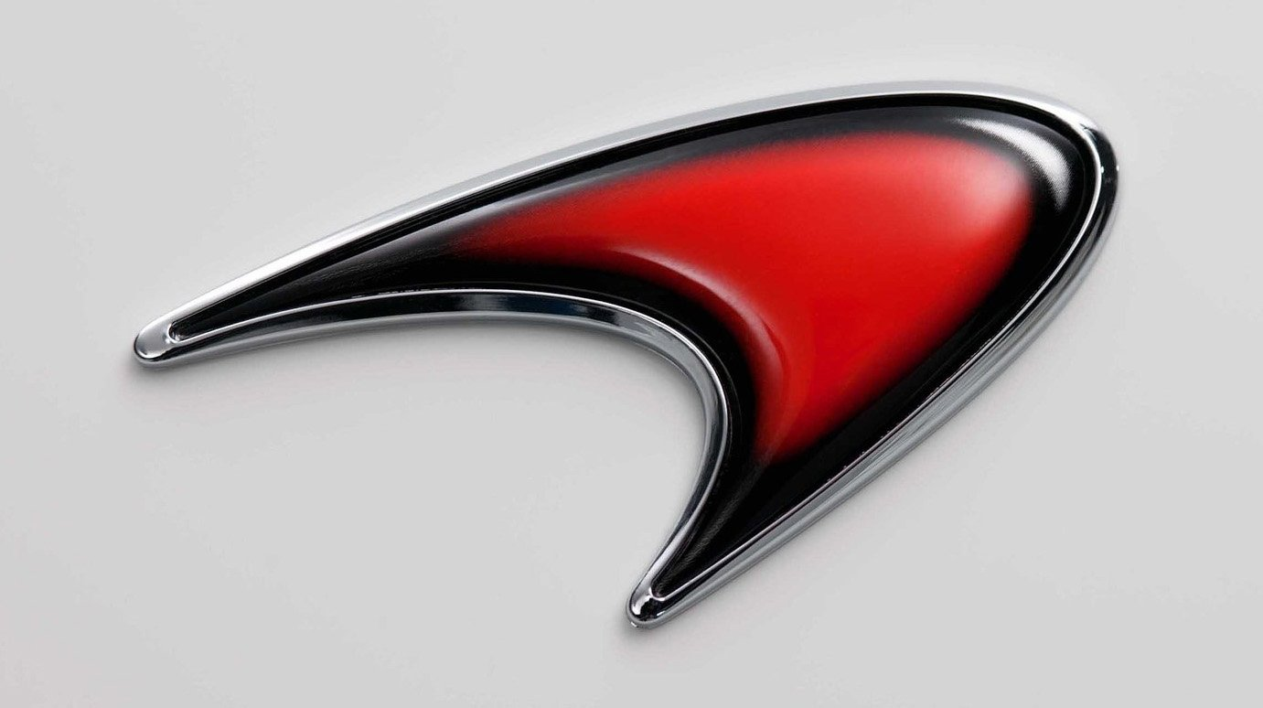 mclaren logo on car. in 1997 the symbol was heavily modified new version which introduced comprised a streamlined speedmark according to companyu0027s mclaren logo on car